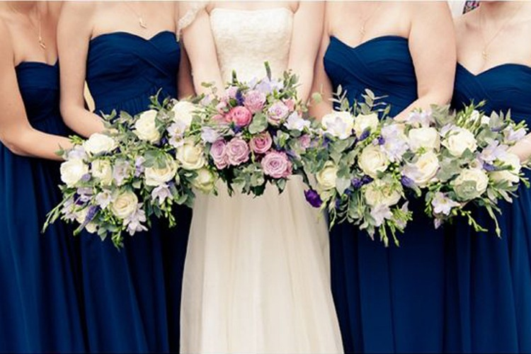 Why Do Bridesmaids Wear The Same Dress?